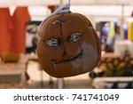 A Creepy Carved Face On A...