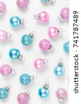 Small photo of Pink amd Blue Christmas balls background. Flat lay, top view