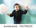 active cute little boy holding... | Shutterstock . vector #741790225
