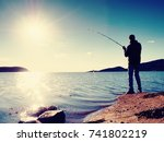 fisherman check fishing line... | Shutterstock . vector #741802219