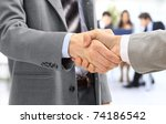 handshake isolated in office | Shutterstock . vector #74186542