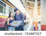 asian couple travelers looking... | Shutterstock . vector #741887317