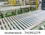 crossing of the roller conveyor ... | Shutterstock . vector #741901279