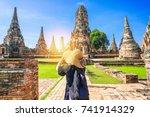 woman traveler with sky blue... | Shutterstock . vector #741914329