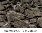 stone wall made of rough edgy... | Shutterstock . vector #741958081