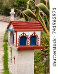 Small photo of Closeup small Hellenic shrine Proskinitari, Greece