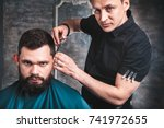 handsome bearded man having his ... | Shutterstock . vector #741972655