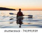woman on a sea kayak is... | Shutterstock . vector #741991939