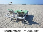 two loungers stand on the beach ... | Shutterstock . vector #742003489