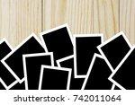 photo frame blank on wood... | Shutterstock . vector #742011064