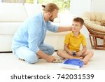 father playing with cute son at ... | Shutterstock . vector #742031539