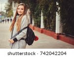 street style portrait of young... | Shutterstock . vector #742042204