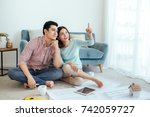happy young asian adult couple... | Shutterstock . vector #742059727