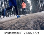 young couple running outdoors... | Shutterstock . vector #742074775