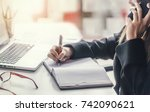 close up businesswoman writing... | Shutterstock . vector #742090621