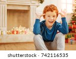 funny redhead boy making faces... | Shutterstock . vector #742116535