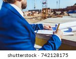 businessman in hardhat and suit ... | Shutterstock . vector #742128175