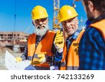 two workers in reflective vests ... | Shutterstock . vector #742133269