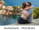 happy young couple hugging in... | Shutterstock . vector #742136161
