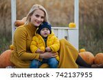 mama with baby and pumpkins     Shutterstock . vector #742137955