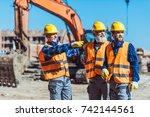 foreman showing builders... | Shutterstock . vector #742144561