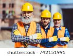 three labour workers posing...   Shutterstock . vector #742151995
