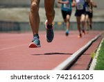 athletics people running on the ... | Shutterstock . vector #742161205