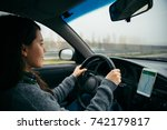 woman driving car by highway in ... | Shutterstock . vector #742179817