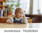 a little boy is sitting at the ... | Shutterstock . vector #742202824