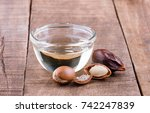 argan seeds and oil on wood | Shutterstock . vector #742247839