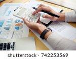 businessman analyzing... | Shutterstock . vector #742253569