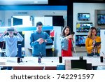 young people buying latest... | Shutterstock . vector #742291597