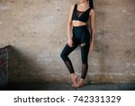 young slim girl in a black... | Shutterstock . vector #742331329