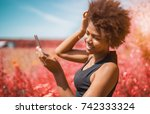 beautiful cheerful young... | Shutterstock . vector #742333324