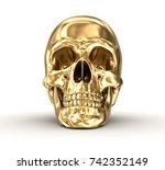 Golden Human Skull Over White ...