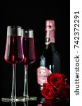 a pair of champagne glasses ...   Shutterstock . vector #742372291