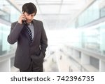happy business man on the phone ... | Shutterstock . vector #742396735