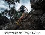 lady hiker passing rocky terrain | Shutterstock . vector #742416184