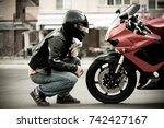 A Guy A Motorcyclist In A...