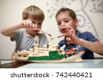 Brothers Painting Wooden Model...