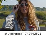 young woman with sunglasses... | Shutterstock . vector #742442521