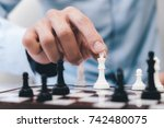 chess game player makes a move... | Shutterstock . vector #742480075