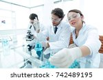 scientist holding test tube or... | Shutterstock . vector #742489195