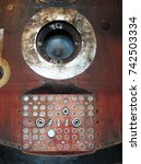 Small photo of soyuz capsule window and connecting panel with reentry burns and scorch marks