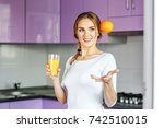 beautiful young woman with... | Shutterstock . vector #742510015