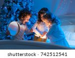 family on christmas eve. happy... | Shutterstock . vector #742512541