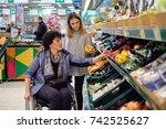 girl helping disabled mothter... | Shutterstock . vector #742525627