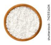 powdered sugar in wooden bowl.... | Shutterstock . vector #742551634