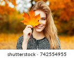 beautiful happy woman with a... | Shutterstock . vector #742554955