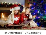 happy little sisters reading a... | Shutterstock . vector #742555849